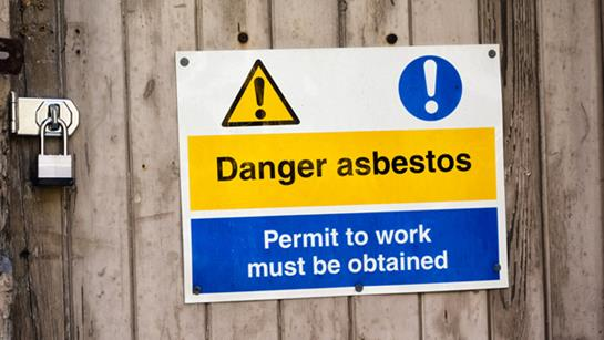 Warning sign about asbestos.