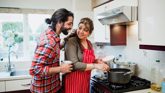 Woman Cooking With Son