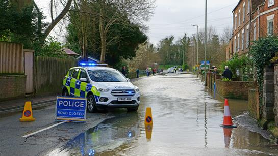 Flooded Road With Police Car