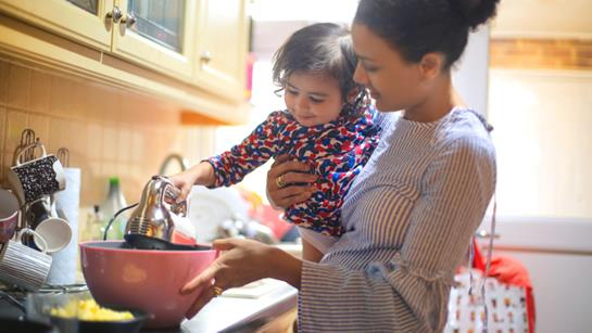 Mother And Young Daughter Cooking Together
